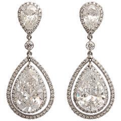 Regal Large Pear Shaped Diamond Dangling Earrings