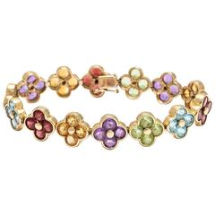 "1980s Multi-Gem Stone Gold Flexible ""Florets"" Bracelet"