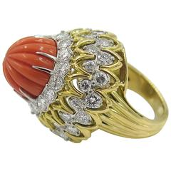 A Beautiful Carved Coral, Platinum, Diamond and Gold Ring.