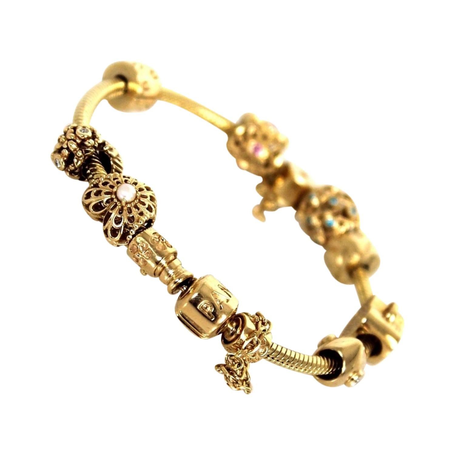 Pandora Gold 8 Piece Diamond Embellished Charm Bracelet at 1stdibs
