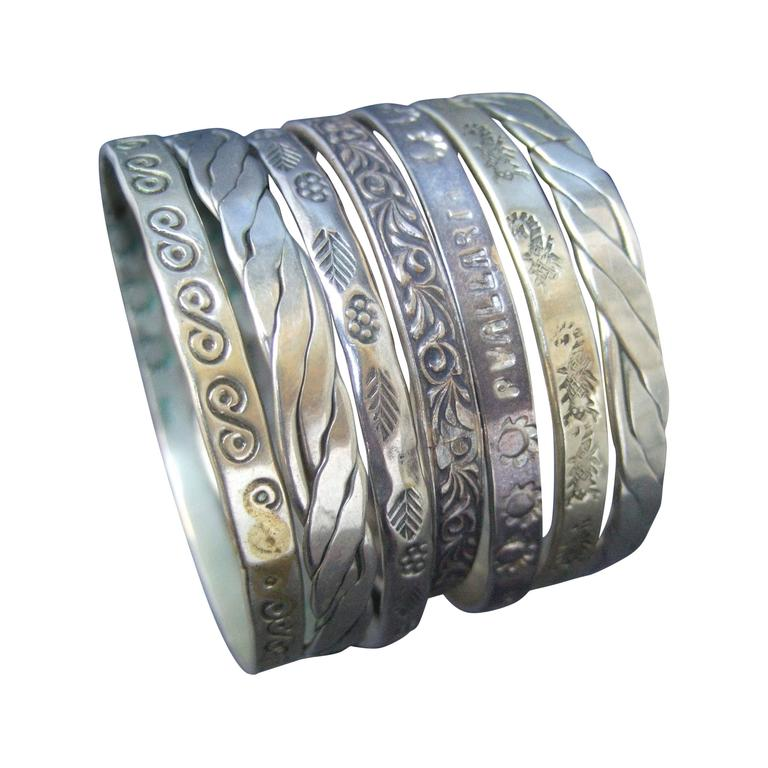 Wonderful Group Of Seven Mexican Sterling Bangle Bracelets c 1960s For Sale