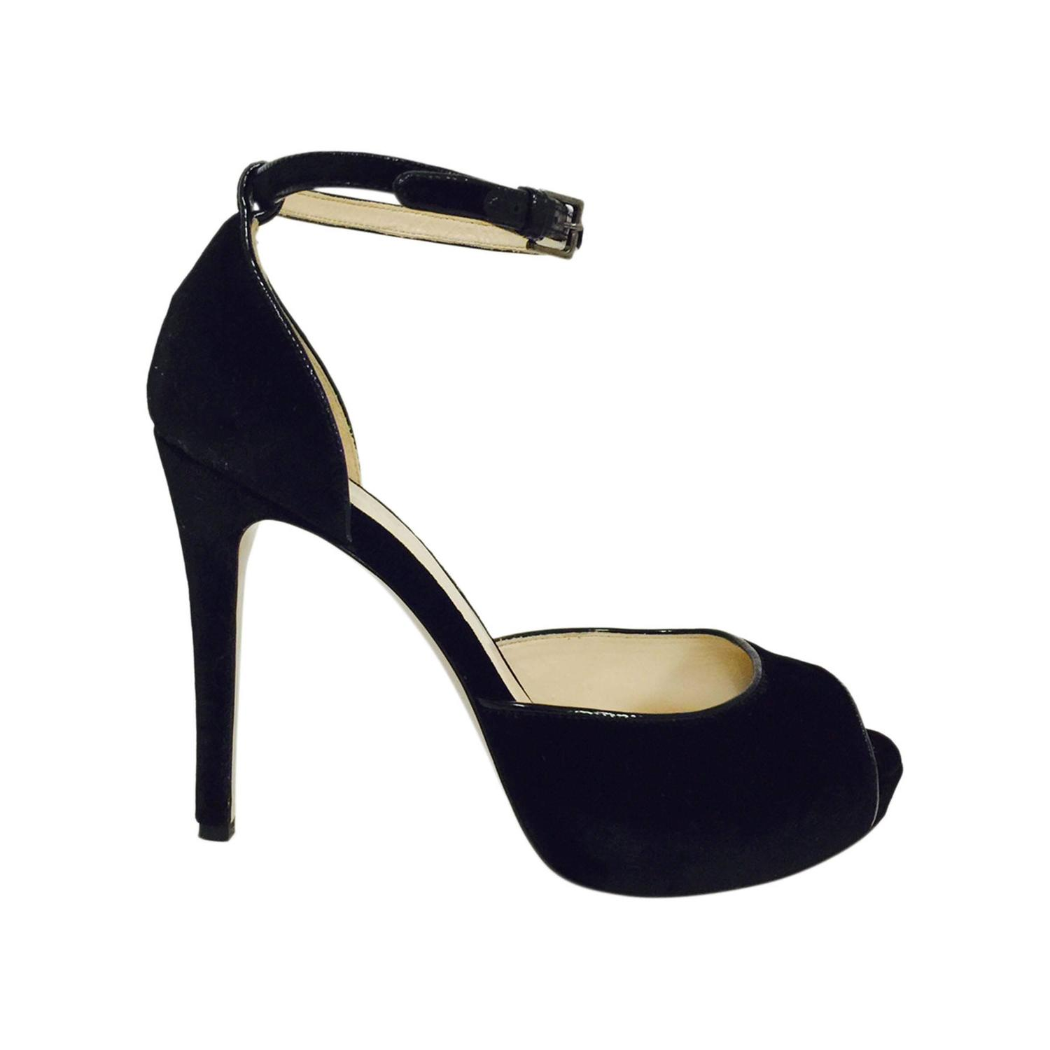 This strappy black high heeled platform sandal is reminiscent of s Old Hollywood Glamour. A sexy classic that will look stunning with vintage inspired evening dresses and prom gowns. ~Black satin ~Ankle strap. ~Peep toe style with rhinestone accent. ~Wrapped platform. ~4