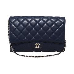 Chanel NWOT Navy Blue Classic Caviar Clutch with Chain Strap