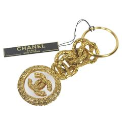 Chanel Gold Tone Textured Charm Key Ring Logo Set in Glass New with Tags
