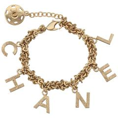 2003 Chanel Gold Tone Link Charm Bracelet Spelling C H A N E L In Charms For At 1stdibs