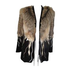 Extravagant black suede jacket with python appliques and wolf/lynx fur