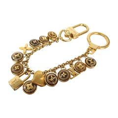 Louis Vuitton Gold Tone Logo Lock Key Bag Charm Chain