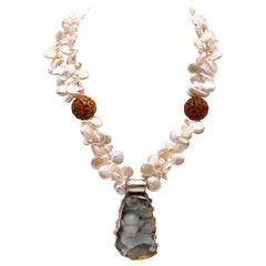 A.Jeschel 2 strand carved jade pendant and pearl necklace.