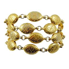 Chanel Multi Strand Gold Tone Logo Bracelet