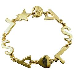 New Vintage Yves Saint Laurent Gold Tone Initial Bracelet