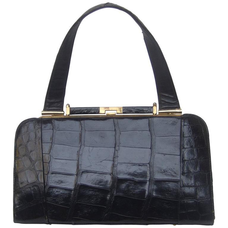 Sleek Ebony Alligator Vintage Handbag ca 1960 For Sale