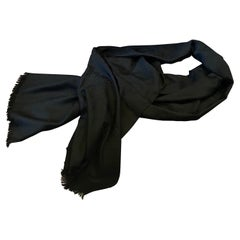 A Never Used Black Wool Scarf with Continuous Logo Gucci