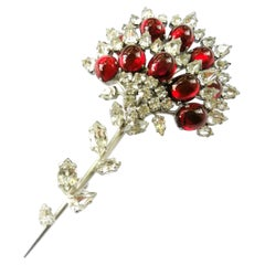 A large paste and cabuchon brooch, Christian Dior, 1960.