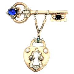 Coro Craft brooch in the shape of a key with attached lock sterling gold plated