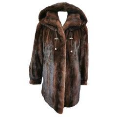 Unused demi buff mink fur coat with a hood size 10