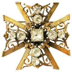 A large gilt and crystal brooch, as a Maltese Cross, Joseff of Hollywood, 1940s