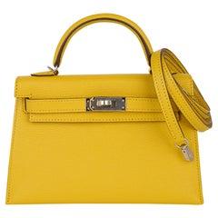 Hermes Kelly 20 Mini Sellier Bag Jaune de Naples Verso Chevre Palladium