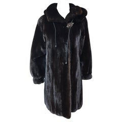 Unused ranch mink fur coat with a hood size 8