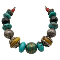 A.Jeschel Powerful Turquoise necklace with a large center bead of Tibetan.
