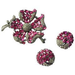 Elegant Trifari ruby and grey paste brooch and earrings, 1950s