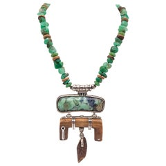 A.Jeschel Carved Fossil Pendant suspendend from a rich green Chrysoprase stones