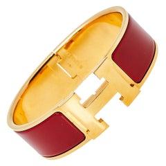 Hermès Clic Clac H Red Enamel Gold Plated Wide Bracelet PM