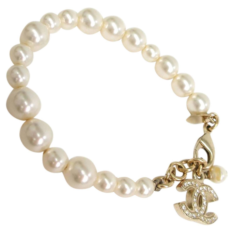 chanel pearl gold rhinestone charm bracelet at 1stdibs