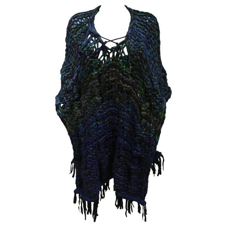Oversized hand made knitted poncho/vest with leather fringing, c. 1970s 1