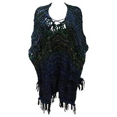 Oversized hand made knitted poncho/vest with leather fringing, c. 1970s