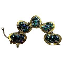 Schiaparelli 1960's Pleated Goldtone Discs Bracelet with Faux Emerald Cabochon