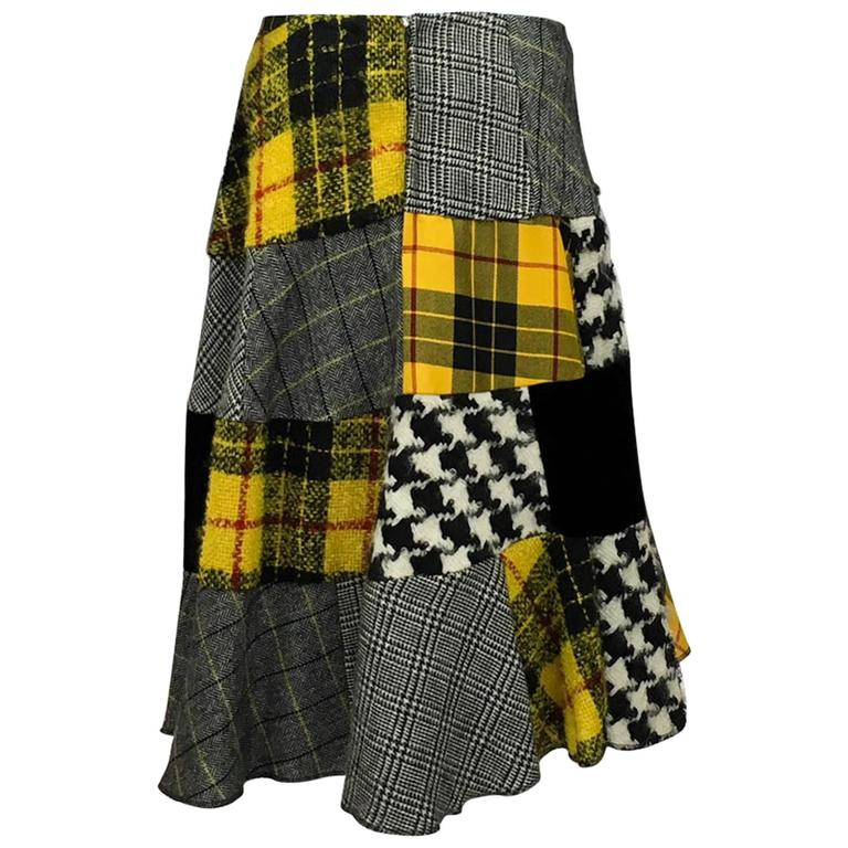 Rare Vintage Comme des Garcons Patchwork Asymmetrical Skirt. Fabulous skirt by Comme des Garcons featuring patch work in plaids, tweeds, mohair and black velvet. This asymmetrical skirt flares out creating a very flattering silhouette. Back zipper.