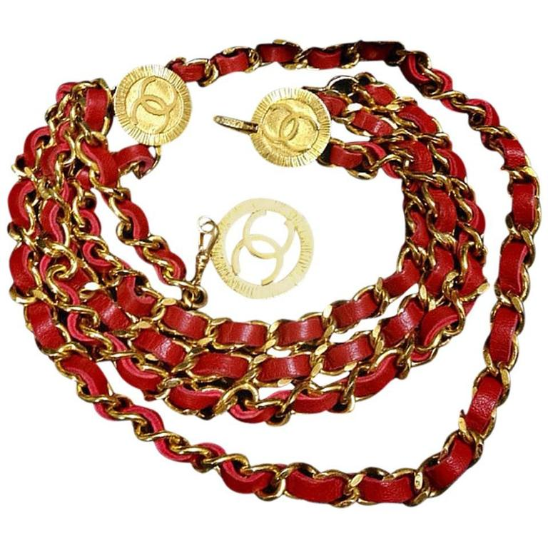 Mint. 80's Vintage CHANEL red leather chain belt with golden CC charms.  1
