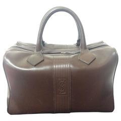 Vintage Yves Saint Laurent genuine dark brown leather daily use duffle bag. Clas