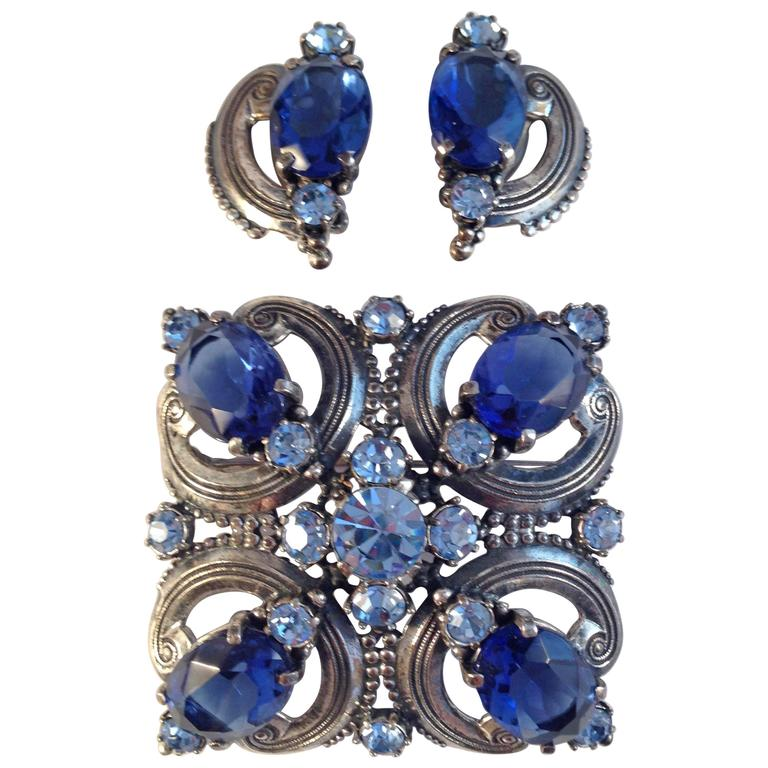 Schiaparelli Brooch and Earrings 1940s Silvertone and Blue Stones  For Sale