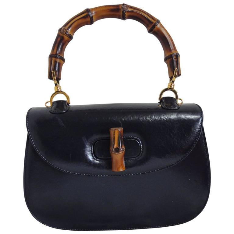 vintage gucci black genuine leather handbag with bamboo handle and red interior at 1stdibs. Black Bedroom Furniture Sets. Home Design Ideas
