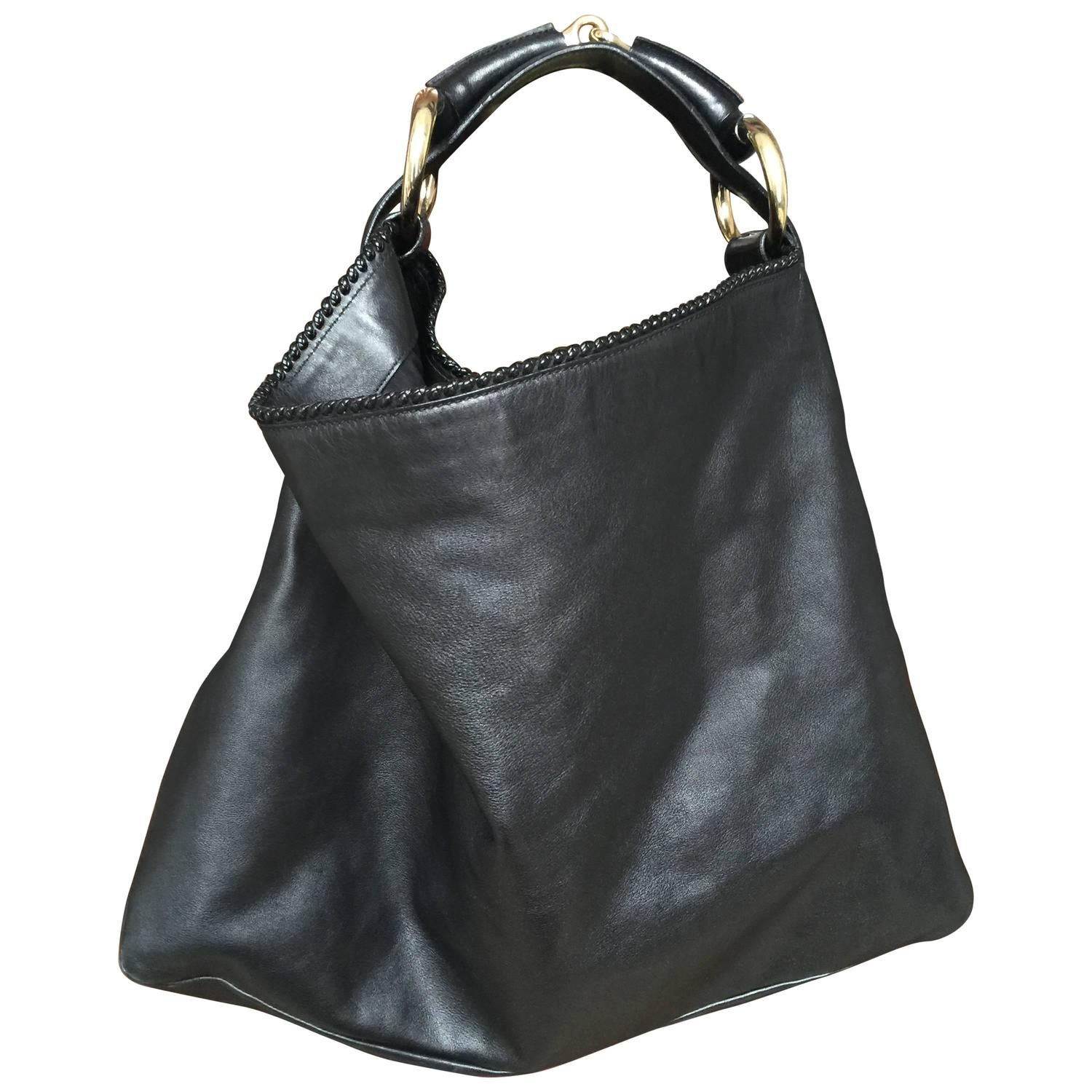 We have large hobo bags that feature roomy compartments to comfortably and securely store all your essentials with ease. Shop Neiman Marcus for a great selection of hobo bags .