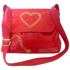 Vintage MOSCHINO red leather messenger shoulder bag with question mark, heart