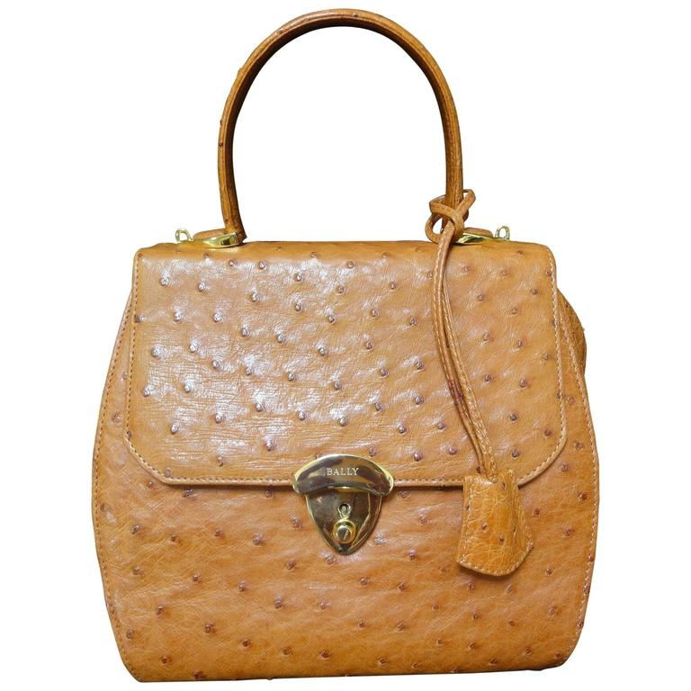 MINT. Vintage BALLY genuine ostrich leather orange brown handbag with strap.