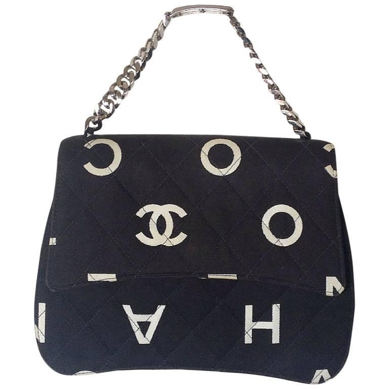 Vintage CHANEL black fabric canvas chain handbag with white Chanel cc logo print For Sale