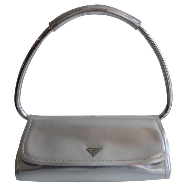 71f419197fd57c Prada Silver Ring Handle Bag at 1stdibs