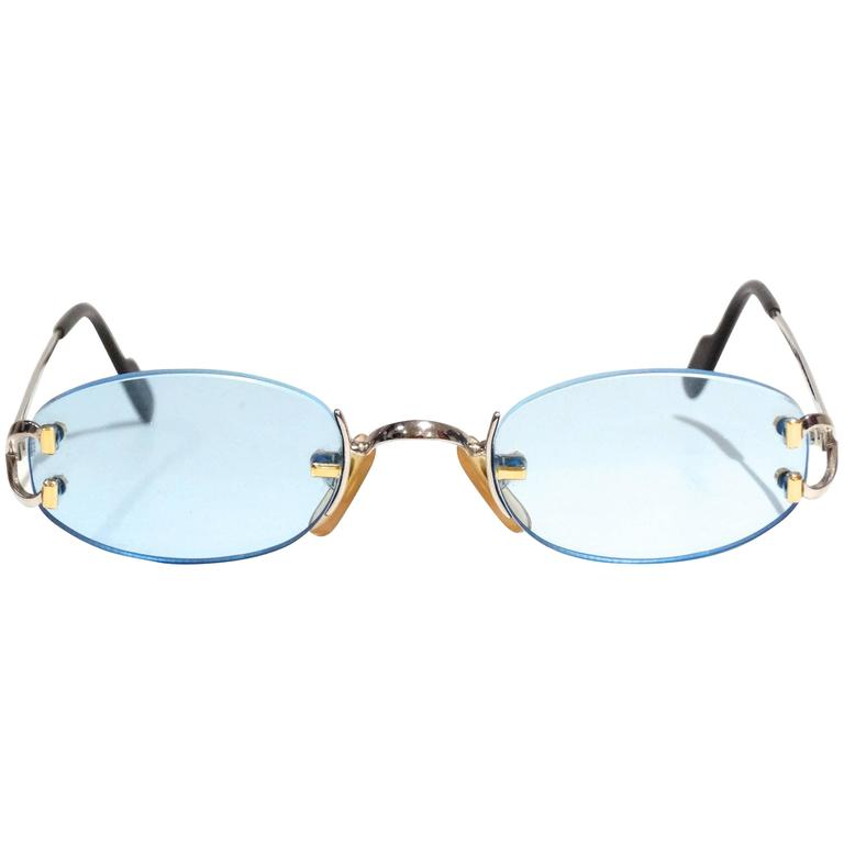 1990s Rimless Cartier Blue Lens Sunglasses at 1stdibs