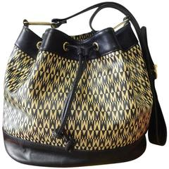 Vintage MOSCHINO black and ivory logo print hobo bucket shoulder bag.