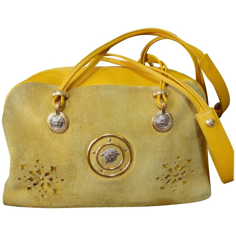 Vintage rare Gianni Versace yellow suede and leather bag with cut out design.