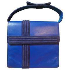 Vintage Gianni Versace blue smooth and suede leather handbag purse with a bow.