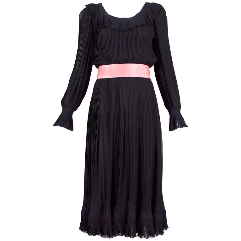 1974 A/H Christian Dior haute couture black silk chiffon pleated dress with ruffled neck, sleeves and hem. Comes with pink silk self tie belt - unsure if belt is original. No size tag so please consult measurements.
