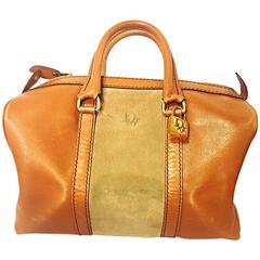 1970s Christian Dior Bagages camel brown mini duffle purse. Unisex bag