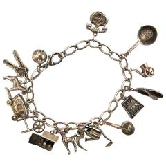 1950's Sterling Silver Bracelet with 14 Charms