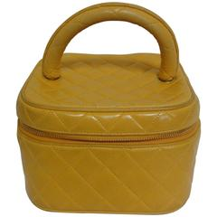 Vintage CHANEL yellow quilted lambskin cosmetic, make up case, mini handbag