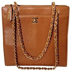 1990s. Vintage CHANEL camel brown caviar leather square shoulder tote bag.