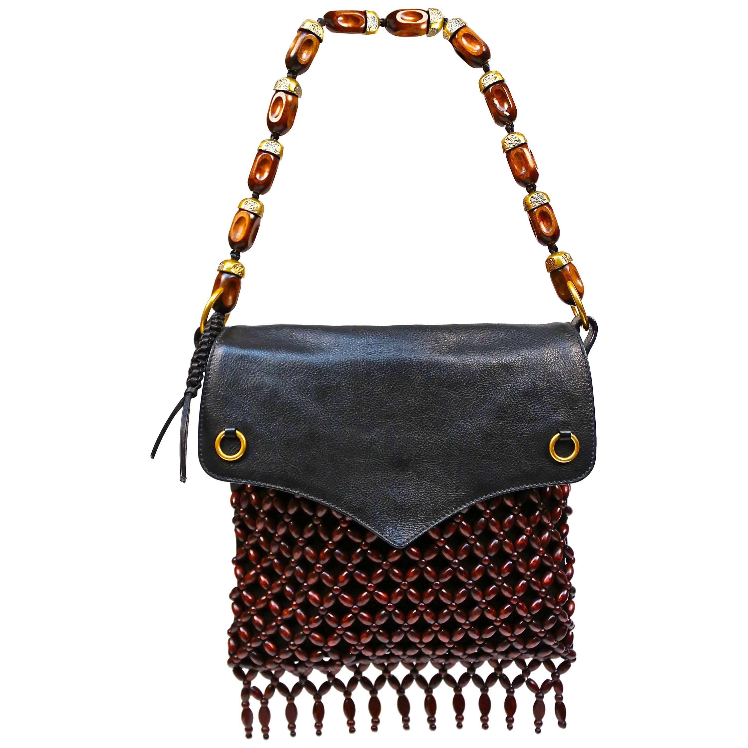Yves Saint Laurent black suede and leather bag with fringed wood beading